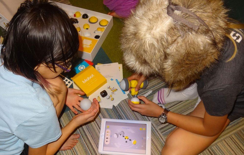 Kids assembling Mabot