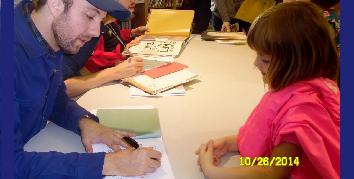 Jon Klassen signs a book for a five year old girl