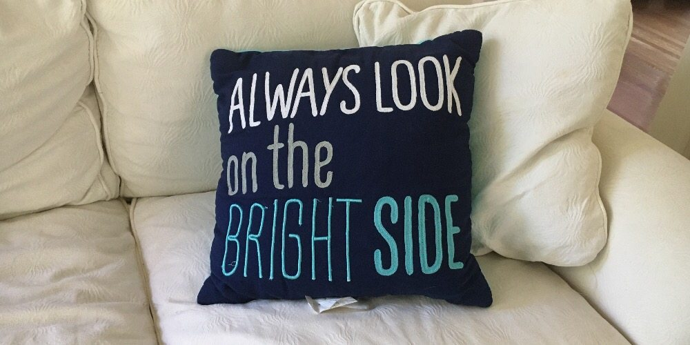 image of pillow saying 'Always Look on the Bright Side'