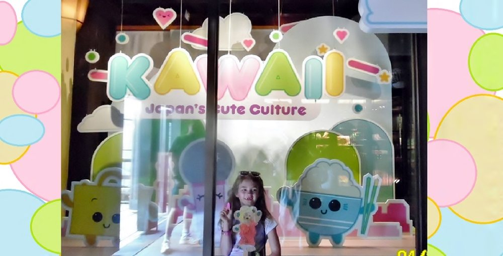 "Child in front of window display reading ""KAWAII: Japan's Cute Culture"" at EPCOT"