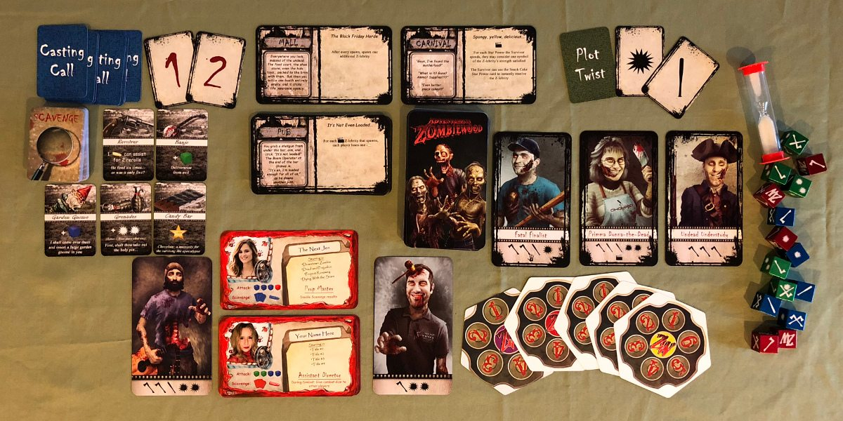 A display showing all of the cards, dice, and other items in Adventures in Zombiewood.