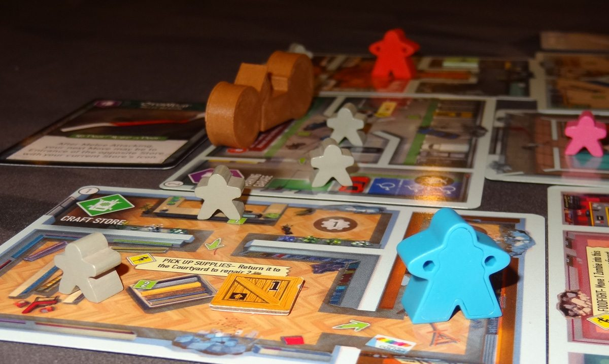 Tiny Epic Zombies game in progress close-up
