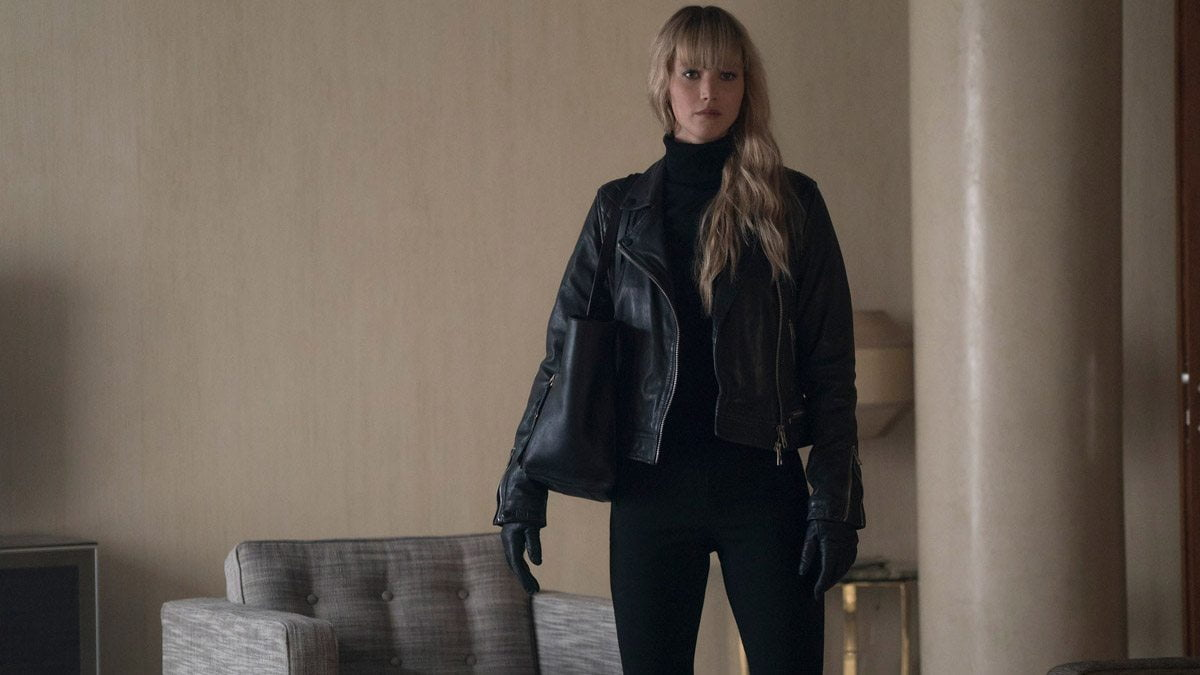 Dominika dons the traditional spy wardrobe. Photo © 20th Century Fox