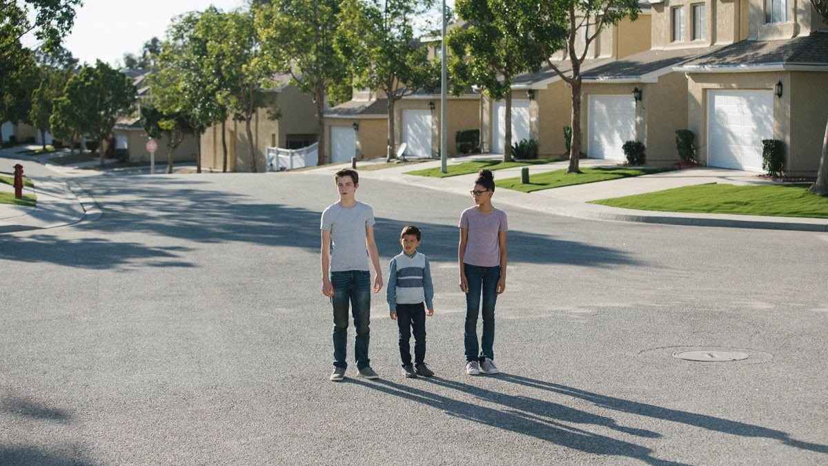 Calvin, Charles Wallace and Meg on a creepy street in 'A Wrinkle in Time'.
