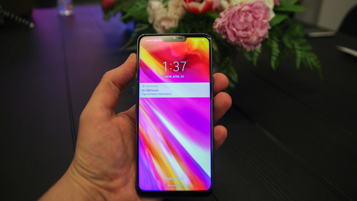 Hand holding up an LG G7 ThinQ smartphone