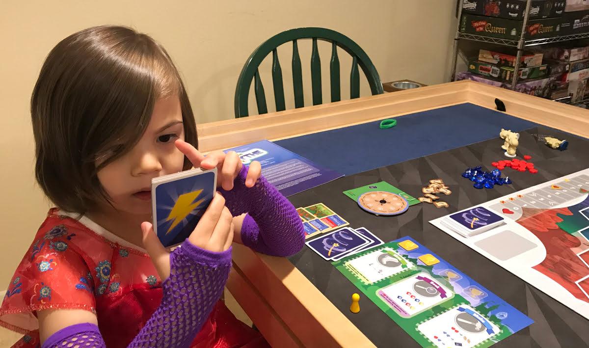 My Little Scythe daughter reads power up tiles