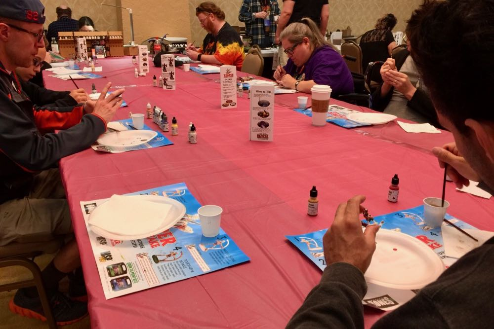 Attendees painting at the Reaper Paint-n-Take