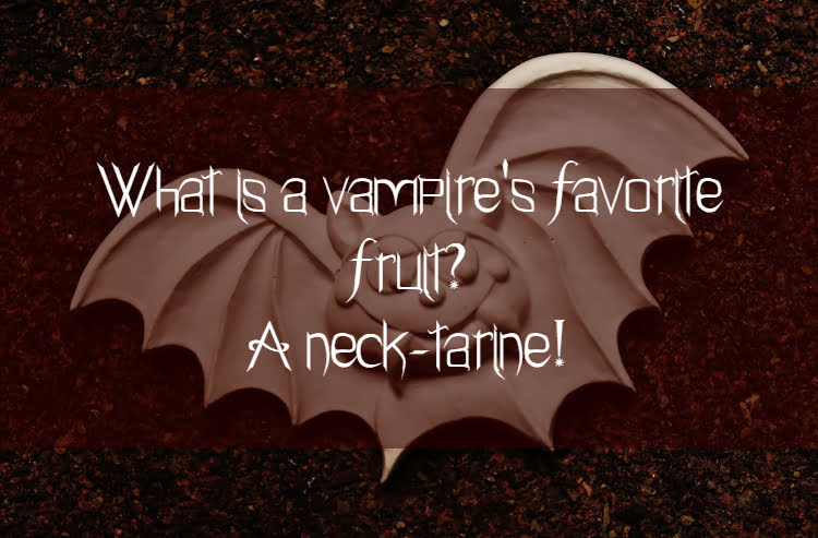 Bat sculpture with text What is a vampire's favorite fruit? A neck-tarine!