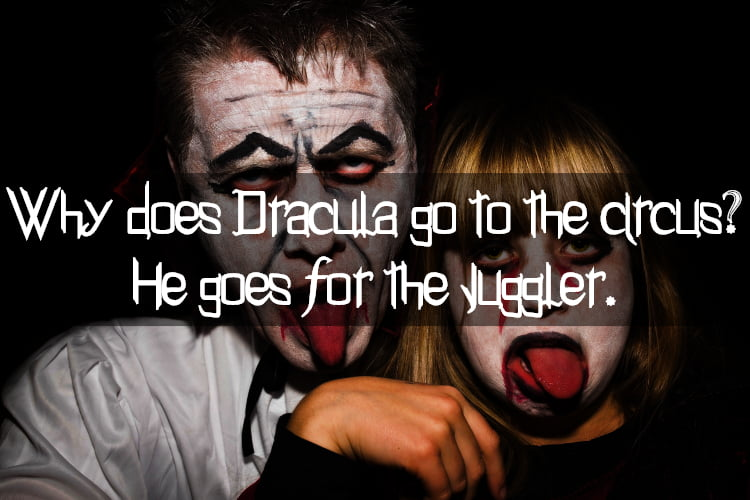 Adult and child dressed as Dracula with halloween joke text Why does Dracula go to the circus? He goes for the juggler.