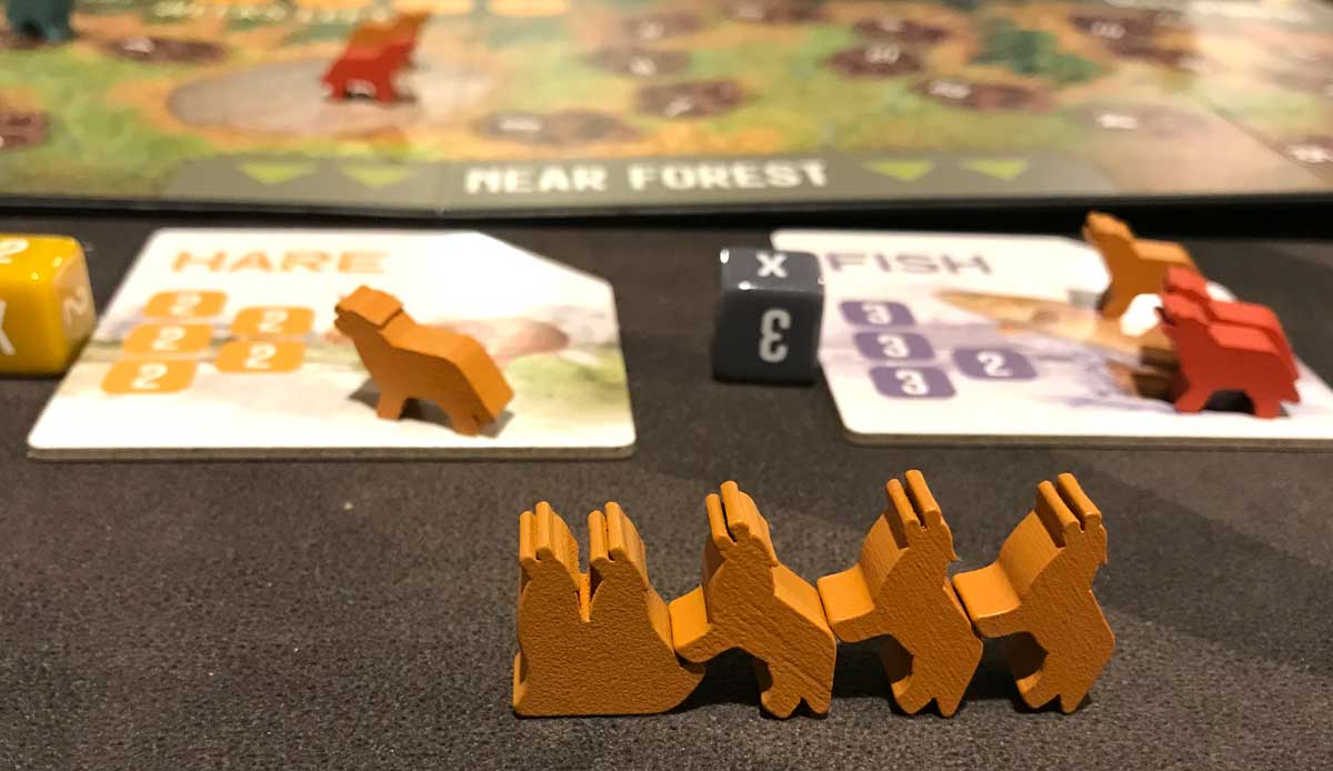 The Alpha - wolf meeples in a conga line