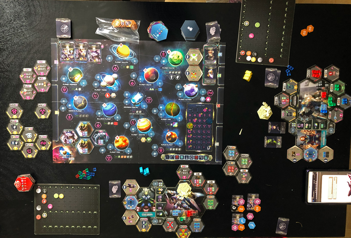 Overhead photo of the tabletop with all of the game components at the end of a two player session.