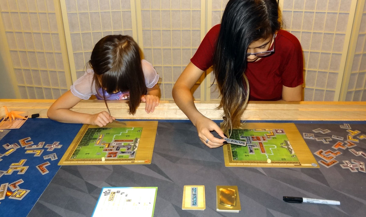 My daughters playing My City