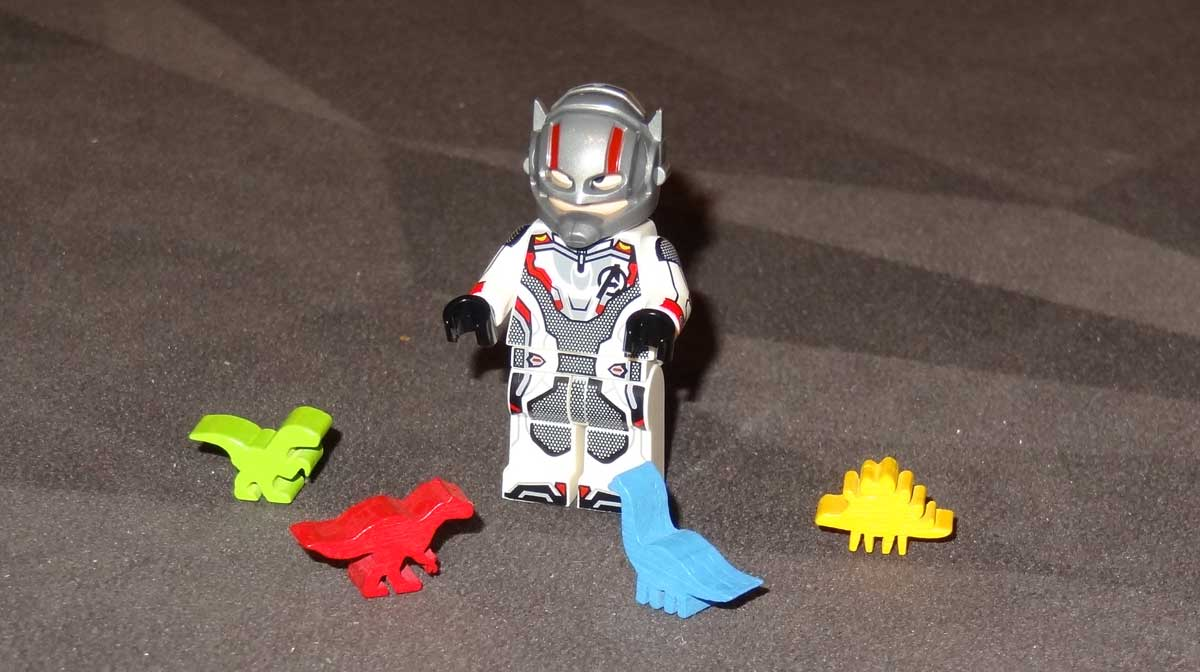 Tiny Epic Dinosaurs dinomeeples with Ant-Man minifig