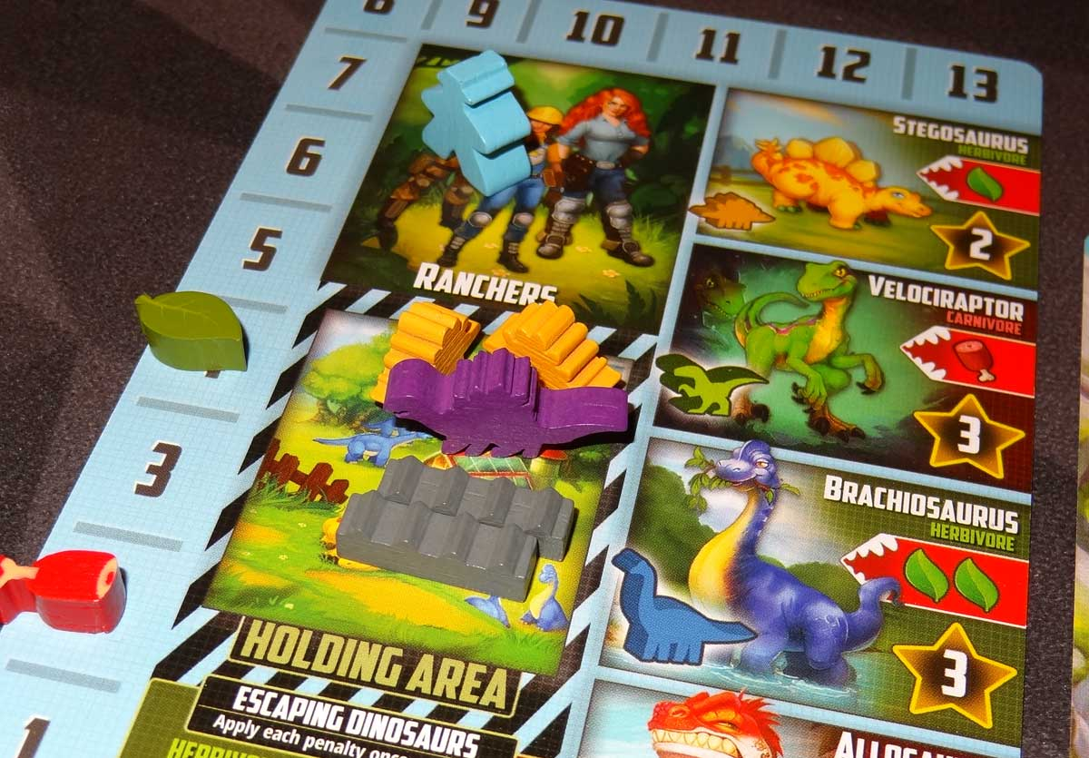 Tiny Epic Dinosaurs player mat close-up