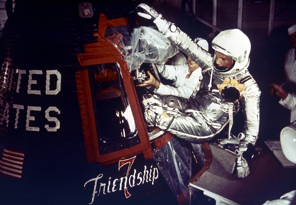 John Glenn climbing into space capsule.