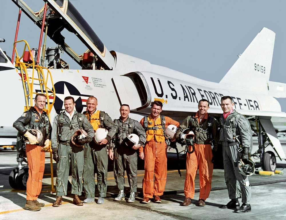 astronauts in front of jet fighter