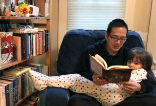 Jonathan reading a book to his daughter