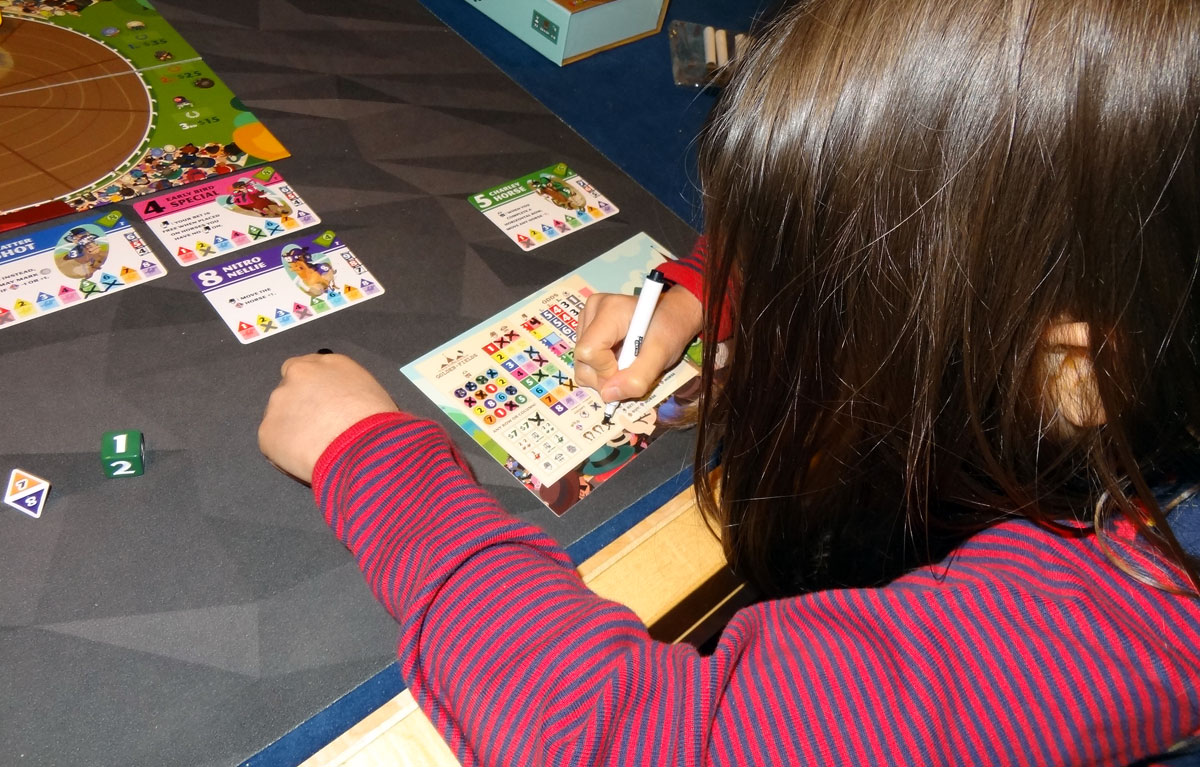 Long Shot: The Dice Game daughter marking her board