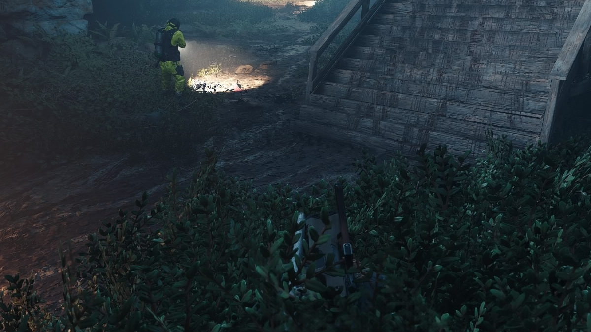 That armed guard can't see Deacon's guns poking out of the bushes.