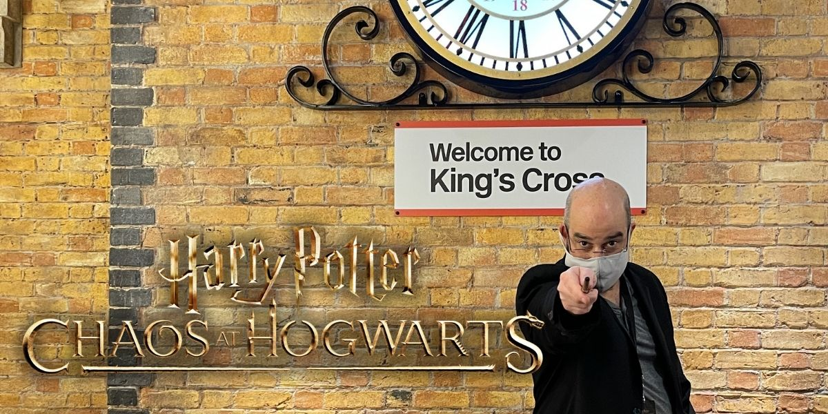 Your intrepid wizard boarding at King's Cross Station for a trip to Hogwarts.