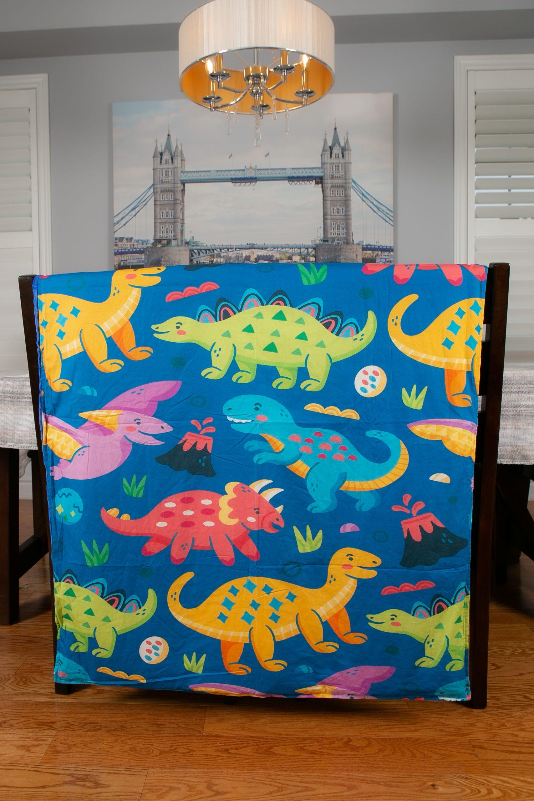 ZOALA blanket dinosaur pattern.