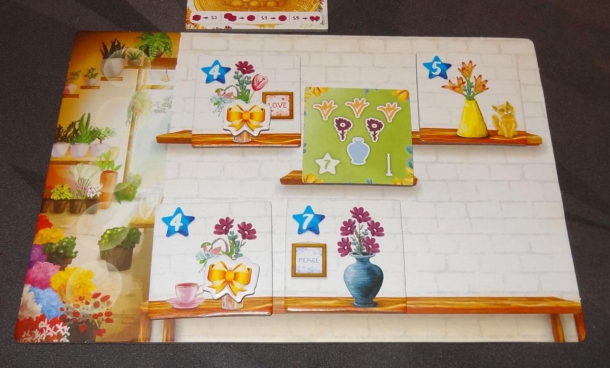 The Little Flower Shop Dice Game shop board with arrangement tiles