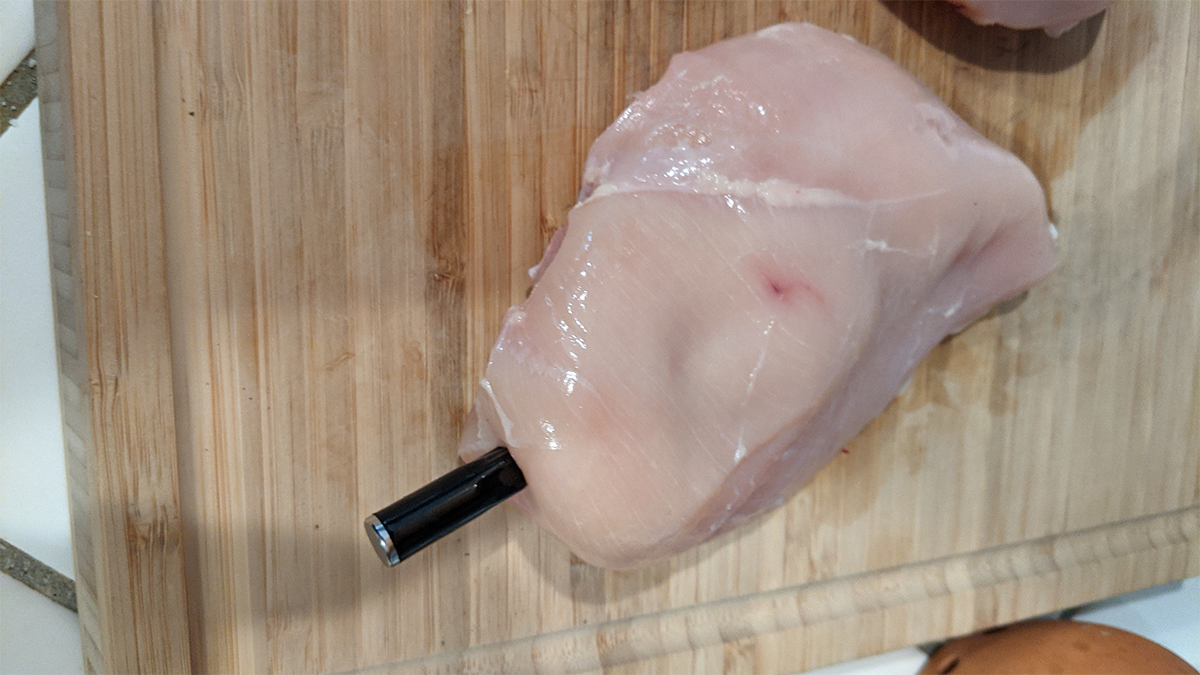 Chicken breast with thermometer inserted